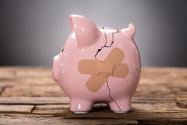 Broken Pink Piggybank With Bandage